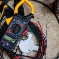 Why choose a career as an electrician? Image shows Volt meter and wiring